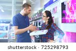 in the electronics store... | Shutterstock . vector #725298793