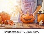 happy halloween  woman carving... | Shutterstock . vector #725314897
