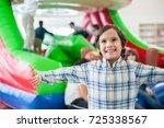 happy kids at indoor playground | Shutterstock . vector #725338567