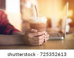 iced chocolate on student desk | Shutterstock . vector #725352613