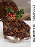 macro slice christmas pudding... | Shutterstock . vector #725390023