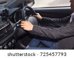 young businessman driving a car | Shutterstock . vector #725457793