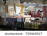 Small photo of APT, FRANCE - JULY 22, 2017 : Colorful market stalls in the little streets of historic center of Apt, in Provence.