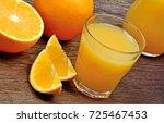 orange fruits with juice in a... | Shutterstock . vector #725467453