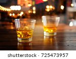 whiskey glass drink with ice... | Shutterstock . vector #725473957