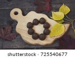 chocolate candies on a wooden... | Shutterstock . vector #725540677