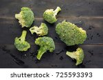 broccoli on black wooden... | Shutterstock . vector #725593393