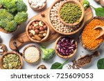 Small photo of Vegan protein source. Beans, lentils, nuts, broccoli spinach and seeds. Top view on white table. Healthy vegetarian food.