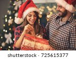 cheerful man and woman opens... | Shutterstock . vector #725615377