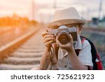 beautiful asian kid shoot... | Shutterstock . vector #725621923