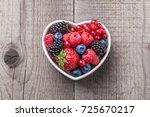 berries overhead mix with... | Shutterstock . vector #725670217