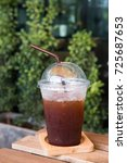Small photo of Ice Americano coffee glass on wood table