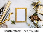 gift box wrapped in black and... | Shutterstock . vector #725749633