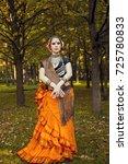 girl in orange ethnic outfit   Shutterstock . vector #725780833