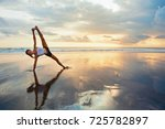 Small photo of Young active woman in yoga pose on sea beach, stretching to keep fit and health. Healthy lifestyle, outdoor fitness, sports activity on summer family holiday.