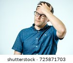 frustrated man with headache... | Shutterstock . vector #725871703