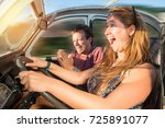 couple in a car at sunset  with ... | Shutterstock . vector #725891077