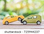 miniature yellow and green car... | Shutterstock . vector #725944237