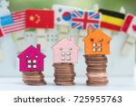 stack coins with house model...   Shutterstock . vector #725955763