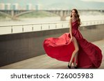 Beautiful Woman In Red...