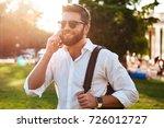 happy bearded man in sunglasses ...   Shutterstock . vector #726012727