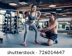 young couple is working out at... | Shutterstock . vector #726014647