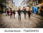 shoppers walking down busy...   Shutterstock . vector #726034453