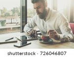 young bearded businessman sits... | Shutterstock . vector #726046807