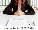 businesswoman sitting at desk... | Shutterstock . vector #726225907