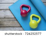 kettlebell and yoga mat on... | Shutterstock . vector #726252577