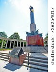 Small photo of Vienna, Austria - June 28, 2017 - Soviet War Memorial (Heroes' Monument of the Red Army), semi-circular white marble colonnade enclosing twelve-metre figure of a Red Army Soldier at Schwarzenbergplatz
