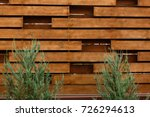 Wooden Fence With Green Lawn...