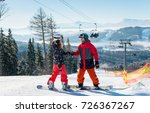 pair of snowboarders on top of... | Shutterstock . vector #726367267