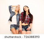 two young girl friends standing ... | Shutterstock . vector #726388393