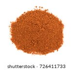Small photo of Top view of a small pile of taco seasoning isolated on a white background.