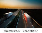 trucks on the road in the sunset | Shutterstock . vector #726428527
