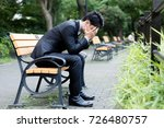 young asian businessman in park | Shutterstock . vector #726480757