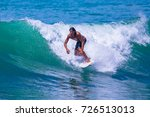 riding the waves. costa rica ... | Shutterstock . vector #726513013