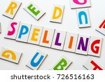 Small photo of word spelling made of colorful letters on white background