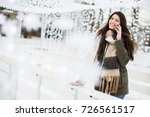 smiling young woman using phone ... | Shutterstock . vector #726561517