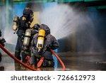 firemen using water from hose... | Shutterstock . vector #726612973