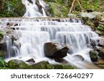 beautiful waterfall on forest... | Shutterstock . vector #726640297