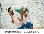 tourist couple enjoying... | Shutterstock . vector #726661273