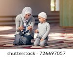 muslim mother teach her son... | Shutterstock . vector #726697057