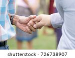 handsome man showing unity | Shutterstock . vector #726738907