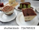 pieces of cakes on white dishes.... | Shutterstock . vector #726785323