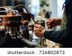 barista steaming milk in milk...   Shutterstock . vector #726802873