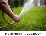 man watering garden with hose ... | Shutterstock . vector #726828907