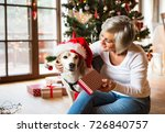 senior woman with her dog... | Shutterstock . vector #726840757