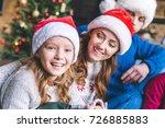 happy mother and daughter in... | Shutterstock . vector #726885883